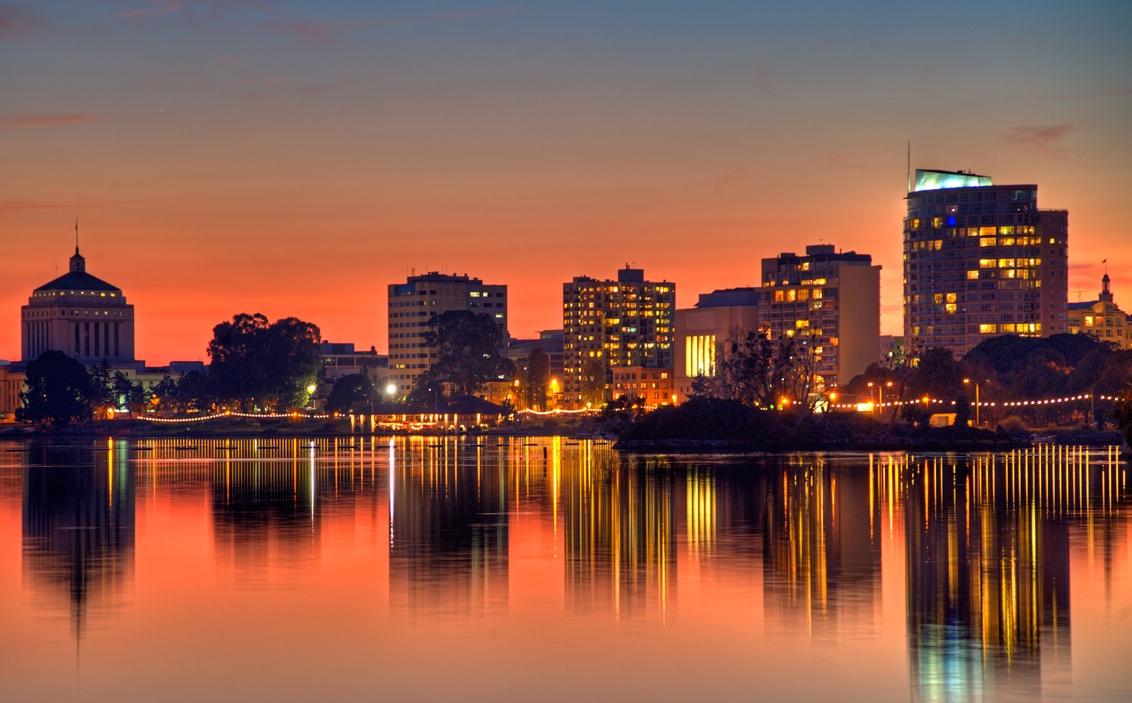 Sunset reflections of buildings at Lake Merritt. Oakland, CA