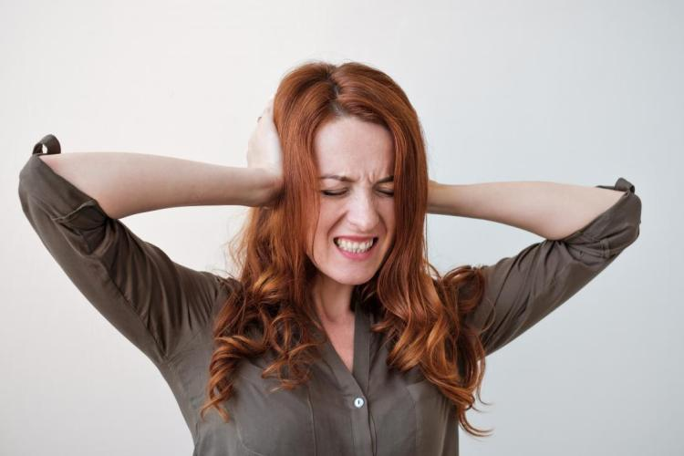 woman-with-misophonia-covering-her-ears-because-she-is-upset-by-noises
